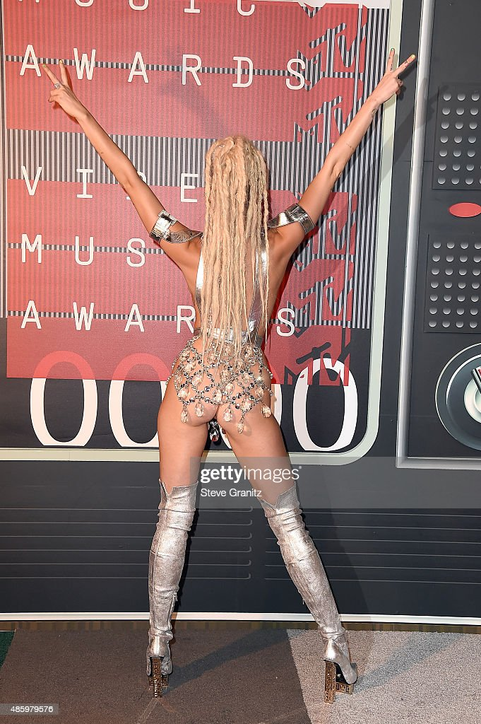 This image contains nudity.] Singer Miley Cyrus, styled by Simone Harouche,, fashion detail, attends the 2015 MTV Video Music Awards at Microsoft Theater on August 30, 2015 in Los Angeles, California.