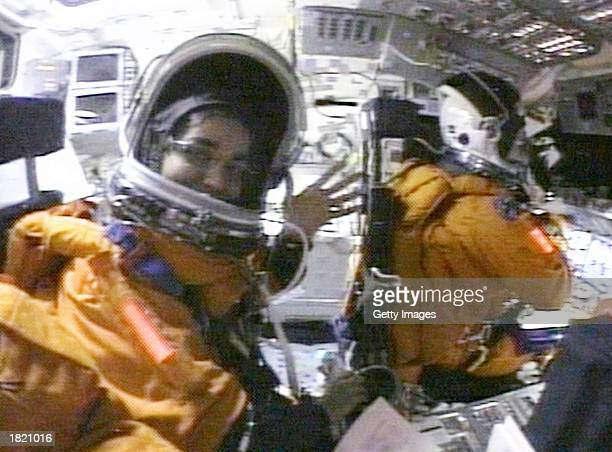 This image from NASA video shot by Shuttle Mission Specialist Laurel Clark shows Mission Specialists Kalpana Chawla and Commander Rick Husband on the...