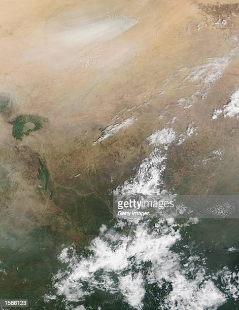 This image from the NASA Terra Satellite shows a large dust storm blowing south towards Lake Chad October 31 2002 in Chad North Africa According to...