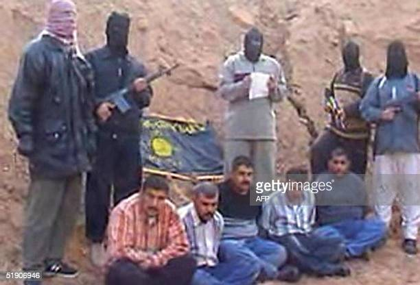 This image grab from a video posted on the internet 01 January 2005 by the Islamist militant group of Abu Mussab alZarqawi AlQaeda Group of Jihad in...