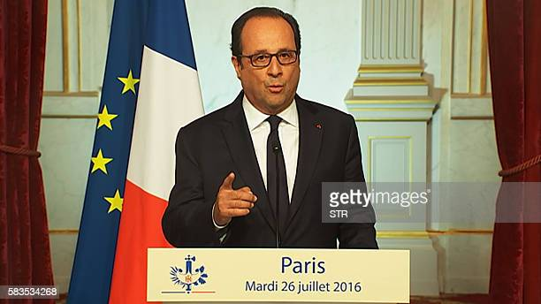 This image grab taken from AFP TV on July 26 shows French President Francois Hollande delivering a speech at the Elysee presidential palace in Paris...