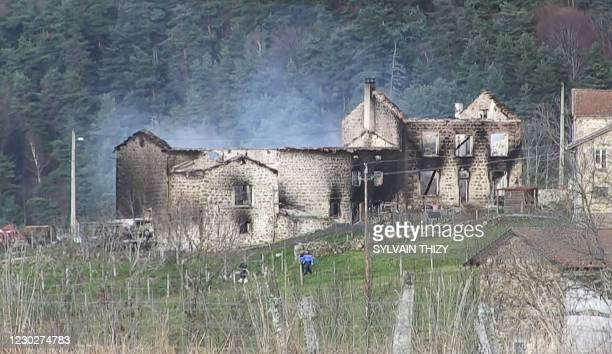 This image grab taken from an AFP TV video a burnt house where three gendarmes were killed and a fourth wounded when a man opened fire as they...