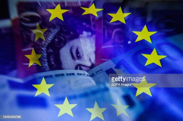EDITORS NOTE This image has been altered [Double exposure] A double exposure image shows an EU flag euro bank notes and British pound bank notes in...