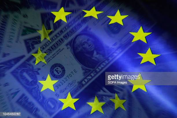 EDITORS NOTE This image has been altered [Double exposure] In this photo illustration a double exposure image shows an EU flag and dollar bank notes