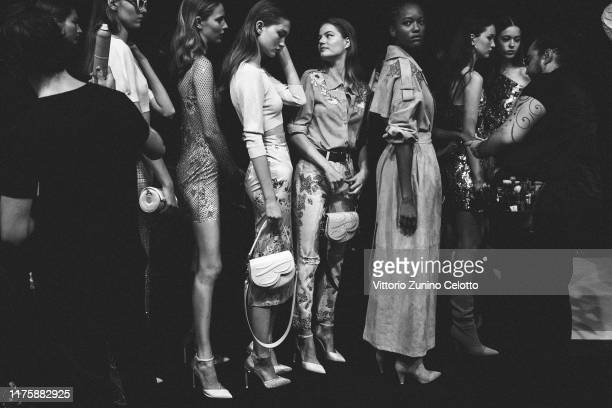 This image has been converted in black and white] Models prepare backstage for Blumarine fashion show during the Milan Fashion Week Spring/Summer...