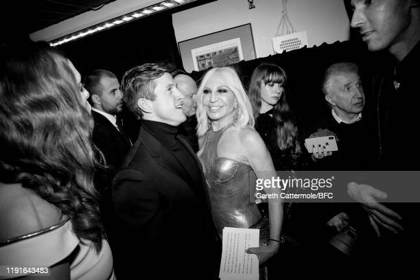 This Image has been converted to black and white) Award winner Daniel Lee for Bottega Veneta and Donatella Versace backstage during The Fashion...