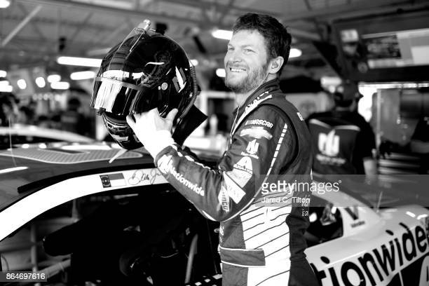 This image has been converted to black and white] Dale Earnhardt Jr driver of the Nationwide Chevrolet stands in the garage area during practice for...
