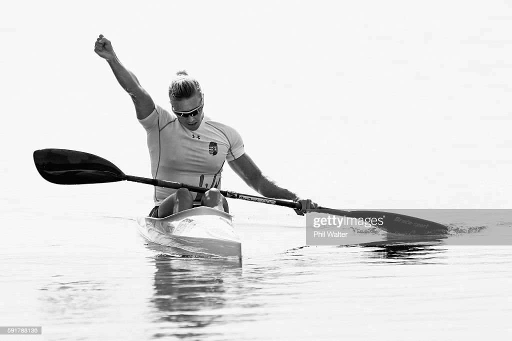 This image has been converted to black and white.] Danuta Kozak of Hungary celebrates after winning gold in the Women's Kayak Single 500m Final at the Lagoa Stadium on Day 13 of the 2016 Rio Olympic Games on August 18, 2016 in Rio de Janeiro, Brazil.
