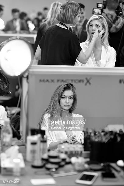 This Image has been converted to Black and White Gigi Hadid and Devon Windsor have their Hair Makeup done prior the 2016 Victoria's Secret Fashion...