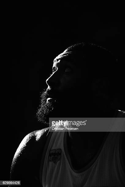 This image has been converted to black and white Kyle O'Quinn of the New York Knicks looks up at the boards while on the bench during the first half...