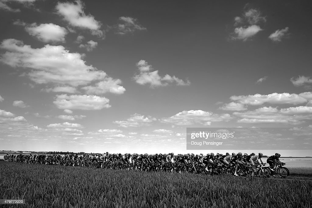 This image has been converted to black and white. Riders pass through the countryside during stage three of the 2015 Tour de France from Anvers to Huy on July 6, 2015 in Huy, Belgium.