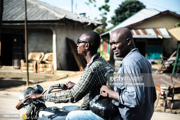 This image is of a man on an 'Okada'; the term used to describe motorcycle taxis in Nigeria. It appears the passenger just came from making a quick...