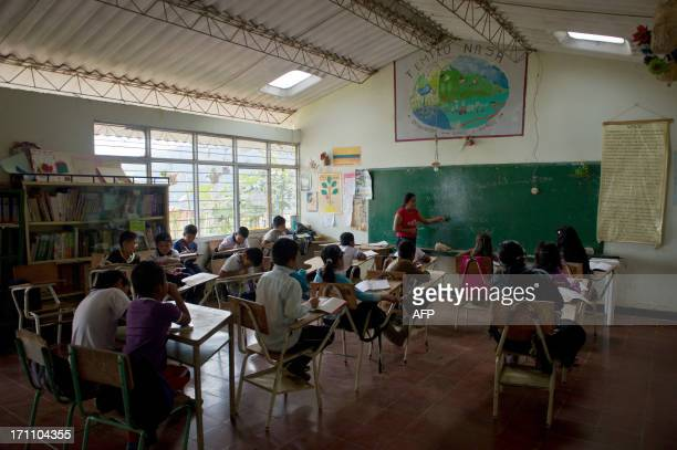 This image is part of a photo package on children going to school around the world. Colombian indigenous child from the Nasa ethnic group Gari Camayo...