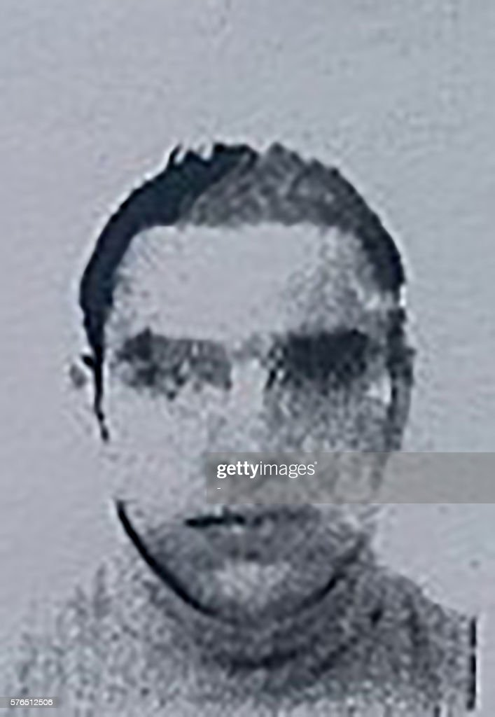 This image obtained by AFP on July 15, 2016 from a French police source shows a reproduction of the picture on the residence permit of Mohamed Lahouaiej-Bouhlel, the man who rammed his truck into a crowd celebrating Bastille Day in Nice on July 14. The attacker, Mohamed Lahouaiej-Bouhlel, a 31-year-old dual national, zigzagged through a crowd gathered to watch a Bastille Day fireworks display in the French city on Thursday night. / AFP / FRENCH