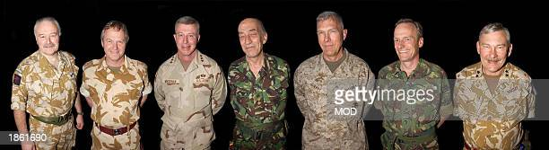 This image released by the British Royal Navy, show seven UK and U.S. Military leaders Major General Peter Wall, Lieutenant General John Reith,...
