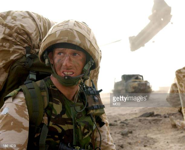 This image released by the British Royal Navy shows British troops landing Ashore on the alFaw peninsula March 21 2003 as they take part in...