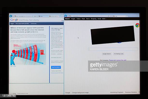 This image shows a computer screen of the Google homepage on January 18 2012 in WashingtonDC Wikipedia on Wednesday goes dark Google blots out its...