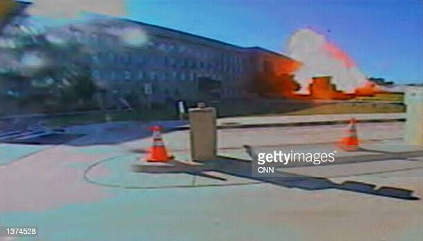 This image shows a hijacked Boeing 757 crashing into the Pentagon on September 11, 2001 in Washington, DC. 200 people were killed in the attack.