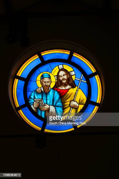 This image shows a stained glass window produced in 2008 featuring Jesus and Saint Joseph Freinademetz who was based in Sai Kung until 1880 and set...