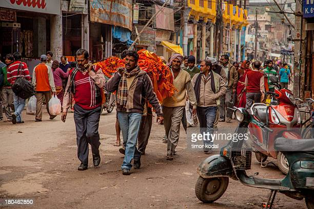 This image shows a traditional Hindu Funeral Procession in honour of a deceased woman in the streets of Varanasi. The depicted mourners constantly...
