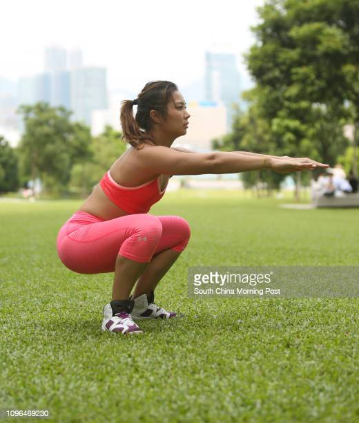 This image shows All About Aesthetics personal trainer Tansy Fong demonstrating Squat Jump at Tamar Park, Admiralty on September 22, 2016 in Hong...