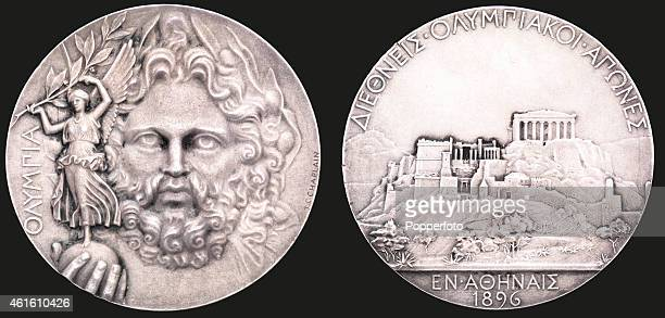 This image shows both sides of a winner's prize medal from the first modern Olympic Games at Athens in 1896 The medal was designed by Jules Chaplain...