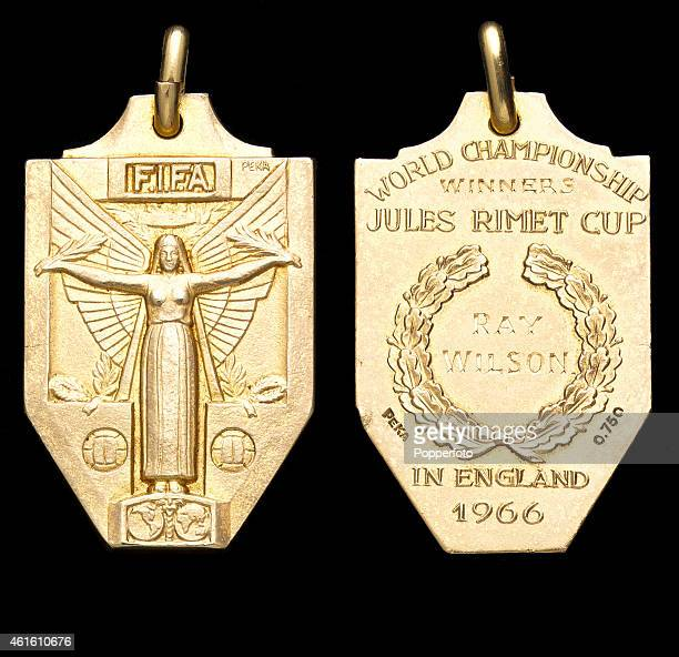 This image shows both sides of the winners medal awarded to England fullback Ray Wilson following their 42 victory over West Germany after extratime...