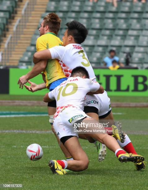 ONLY*** This image shows Brazil's Lucas Muller tackled by Japan's Yoshitaka Tokunaga and Kazushi Hano during qualifiers Japan vs Brazil of the Cathay...