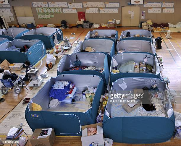 This image shows evacuees living in partitioned rooms at a shelter in Kamaishi in Iwate prefecture on April 12 2011 a month after the March 11...