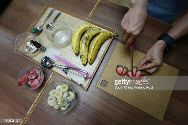 This image shows Iris Mak cutting up fruit for a meal The 41yearold former media sales professional Iris's picked up a silver award at the Hong Kong...