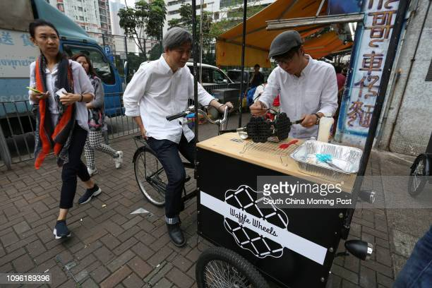 This image shows Niles Mak Siuchun and Chan Kahing who turn bicycles wagons and other objects with wheels into food trucks selling waffles etc at the...