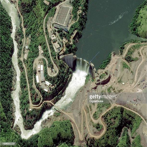 This image shows the Cambambe Dam on the Cuanza River located on the border of Angola's Cuanza Norte and Cuanza Sul Provinces The dam is 172...