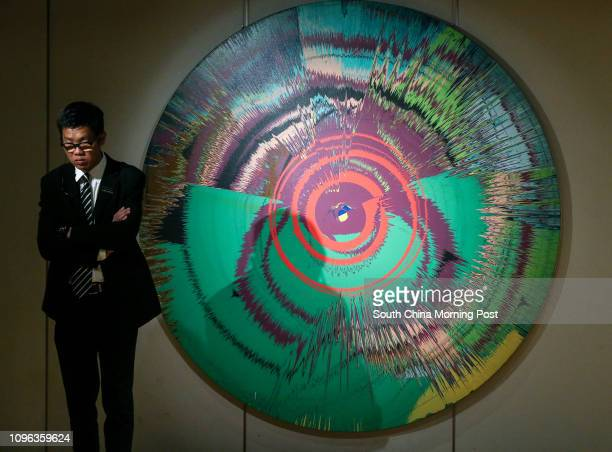 This image shows the 'Damien Hirst with David Bowie Beautiful hallo spaceboy painting 1995 Estimate ¨£250000ǃÏ350000' during Sotheby's HK Media...