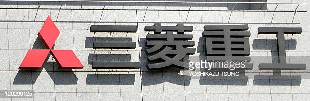 This image shows the logo for Mitsubishi Heavy Industries at the company's headquarters in Tokyo on August 4, 2011. Japanese electronics giants...
