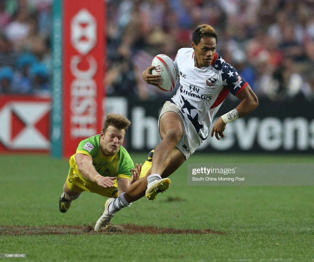 ***FOR NON-COMMERCIAL USE ONLY*** This image shows United States's Maka Unufe (right, white) tries to break through the Australia's defence on the second day of the Cathay Pacific/HSBC Hong Kong Sevens 2016. 09APR16   SCMP/ Sam Tsang    [RUGBY SEVENS] : News Photo