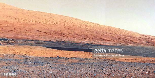 This image taken by the Mast Camera on NASA's Curiosity rover highlights the interesting geology of Mount Sharp a mountain inside Gale Crater where...