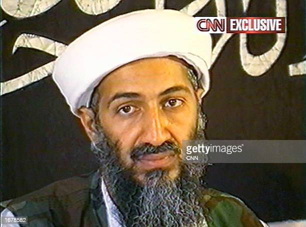 This image taken from a collection of videotapes obtained by CNN shows Saudi terrorist suspect Osama bin Laden speaking at a press conference on May...