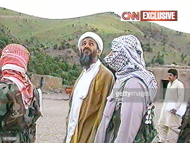 This image taken from a collection of videotapes obtained by CNN shows Saudi terrorist suspect Osama bin Laden and his unidentified body guards...