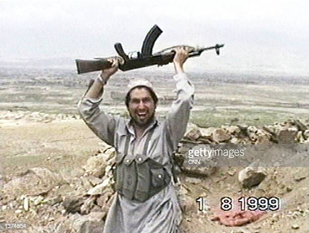This image taken from a video obtained by CNN shows a member of al Qaeda's elite fighting group Force 055 as he celebrates the taking of Bagram Air...