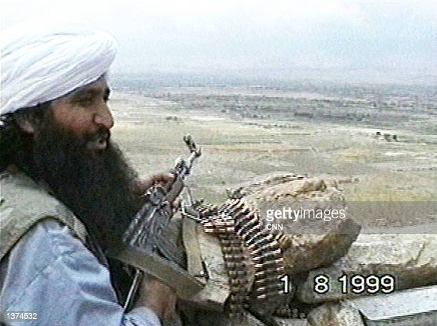 This image taken from a video obtained by CNN shows a member of the Taliban or al Qaeda's elite fighting group 'Force 055' as he talks about fighting...