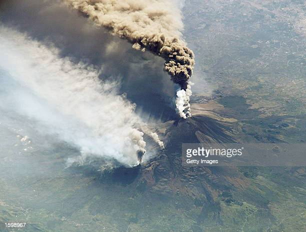 This image taken from cameras onboard the International Space Station shows plumes of smoke and ash erupting from Mount Etna on October 30 2002 in...