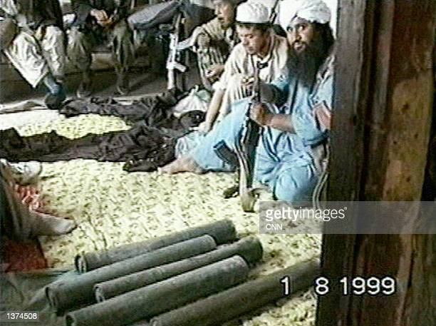 """This image taken from video obtained by CNN shows members of the Taliban and al Qaeda's elite fighting group """"Force 055"""" as they celebrate the taking..."""