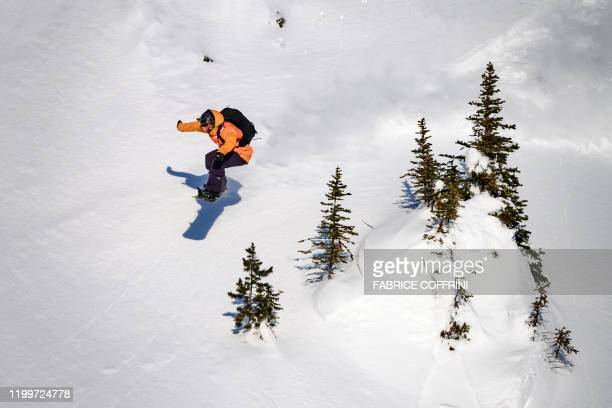 This image taken on February 7 2020 shows freeride snowboarder Claudia Avon of Canada competing during the Women's snowboard event of the second...