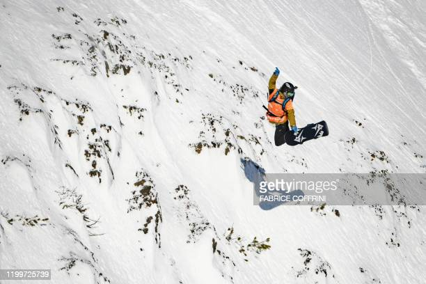 This image taken on February 7 2020 shows freeride snowborder Davey Baird of the US competing during the Men's snowboard event of the second stage of...