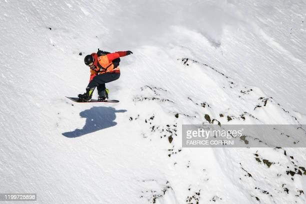 This image taken on February 7 2020 shows freeride snowborder Jonathan Penfield of the US competing during the Men's snowboard event of the second...