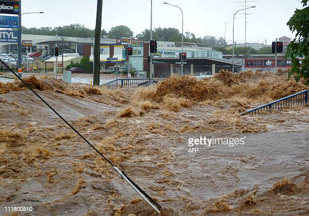This image taken on January 10 2011 shows flood waters swamping the shopping centre as flash floods inundate the city of Toowoomba Australia braced...