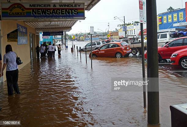 This image taken on January 10 2011 shows waters swamping the shopping centre as flash floods inundate the city of Toowoomba Australia braced for a...