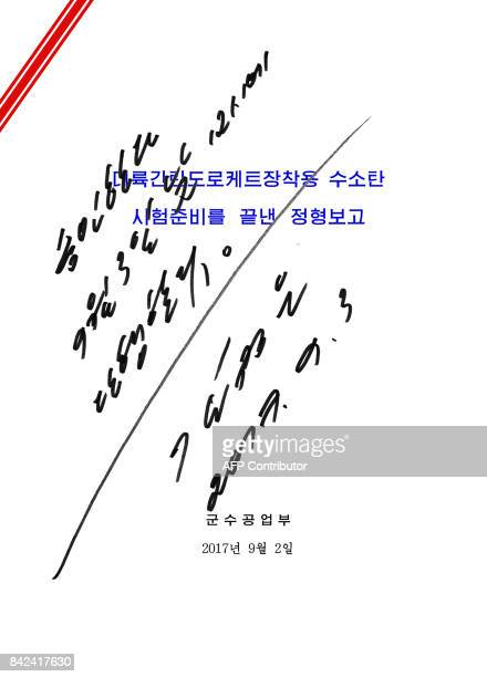 This image taken on September 3 2017 and released by North Korea's official Korean Central News Agency on September 4 2017 shows a copy of the order...