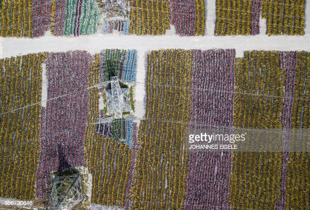 This image taken with a drone shows numerous abandoned public shared bicycles at a lot in Shanghai on May 10 2018 China issued national guidelines...