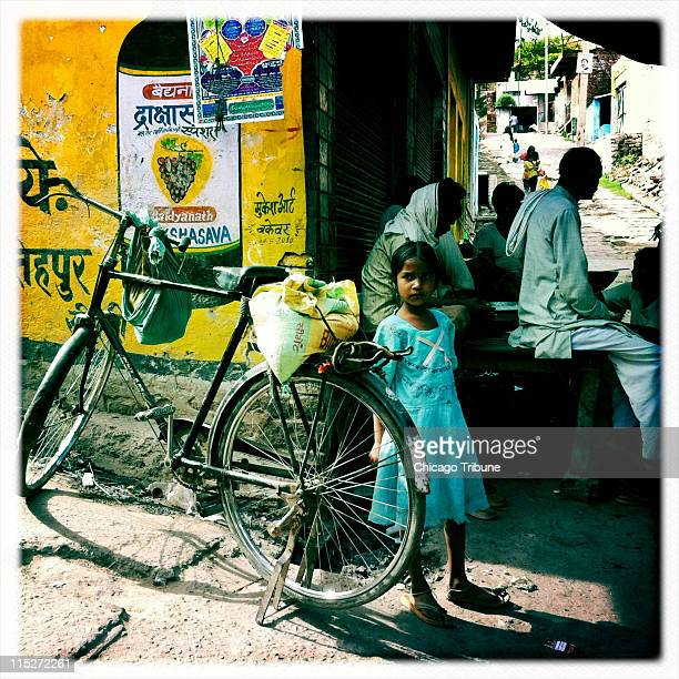 This image taken with the Hipstamatic App for iPhone shows a young girl waiting on the streets near Fatehpur Sikri in the Agra District in the...